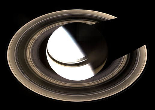Saturn casting a shadow back across its rings